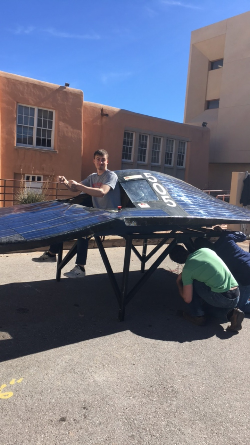 Above: Picture of the Solar Splash Team evaluating condition of solar panels and having a good time