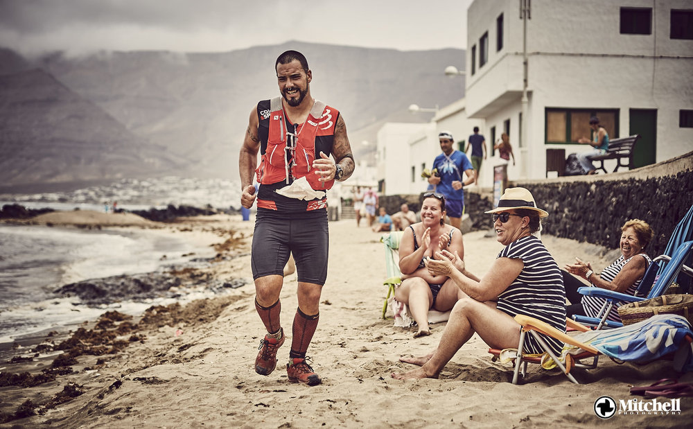 Love the juxtaposition of this trail runner in his final 100metres of the Famara Total