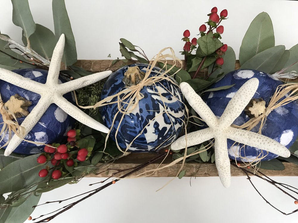 I added real foliage and starfish in a wood bowl to finish the center piece off.