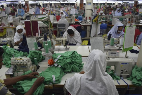 Still of Bangladeshi women in sweatshop from  The True Cost