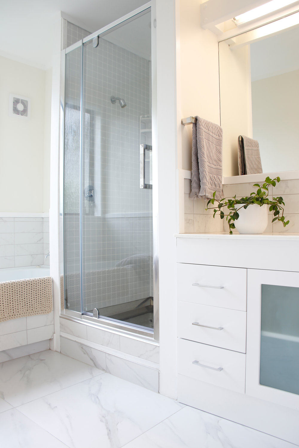 What would it be like to live with a newly-renovated bathroom ? I imagine I would enjoy the clean lines and simplicity. Underfloor heating would be nice in winter. But would the walls remain blank for fear of making a hole in fresh paint work ?