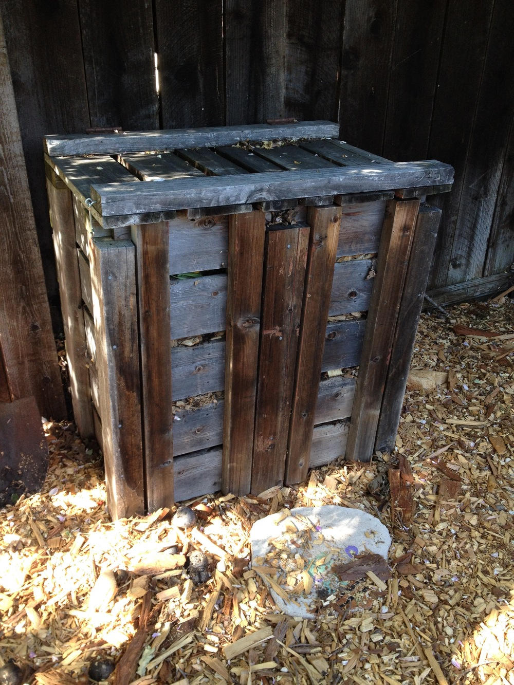 Compost/Worm Bin, several years ago before plants surrounded it. Dad made this out of reclaimed redwood and it has lasted 12 years so far.