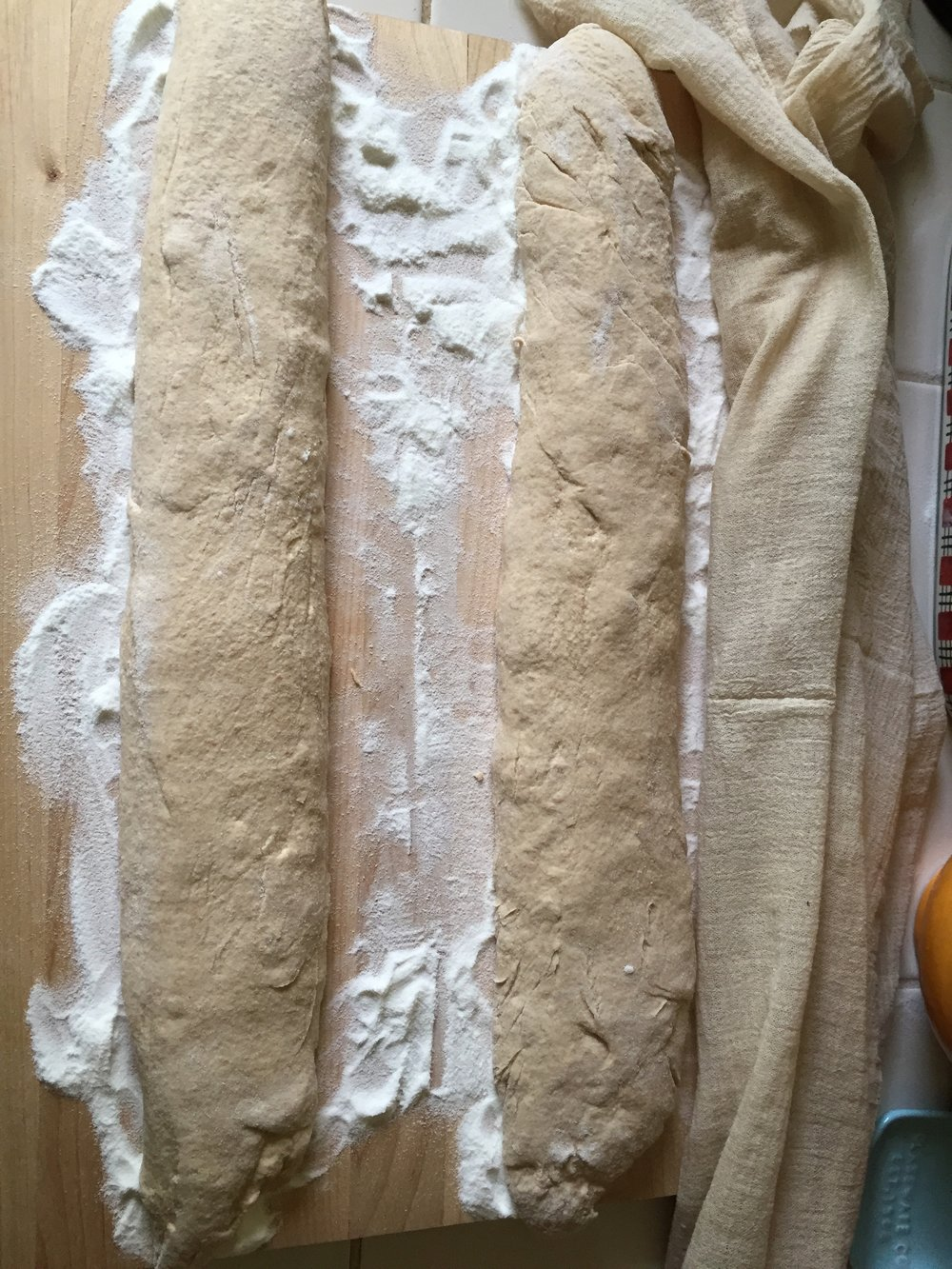 That's rice flour I'm using for the shaping and dusting, and a cheesecloth for covering them while they rest.