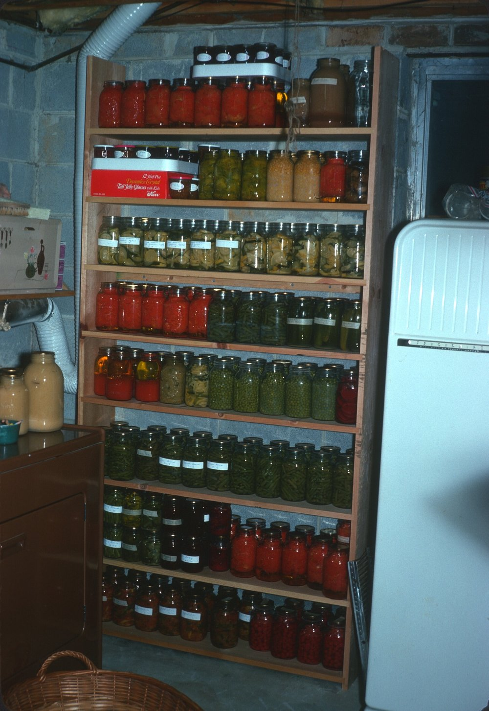 My mom's canning shelf, circa 1975; Gaithersburg, Maryland