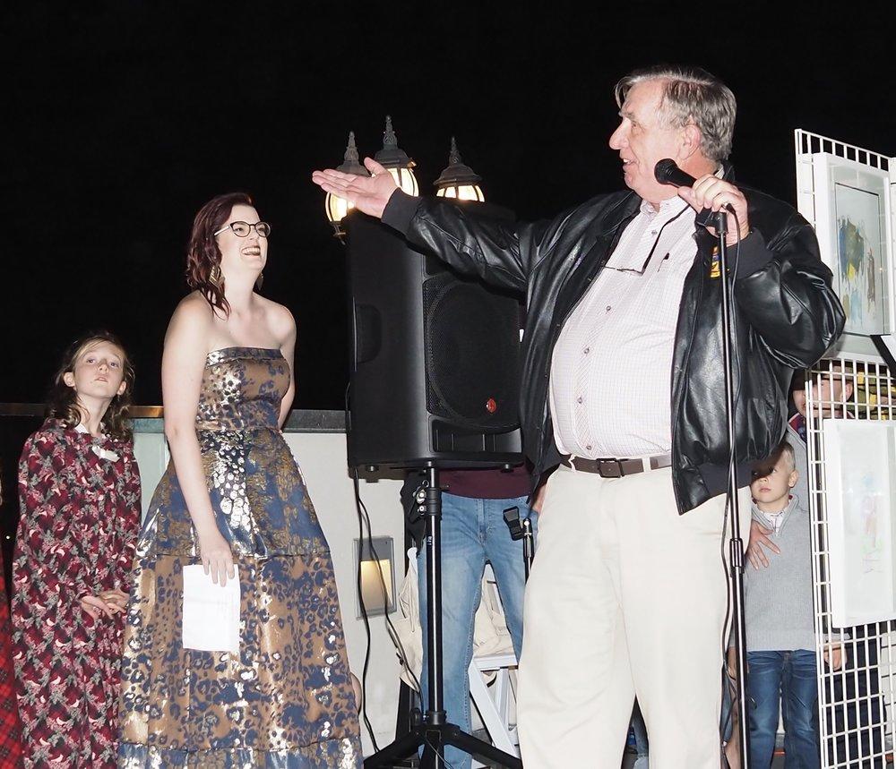 A Christmas Caroler,Liz Murphy and Jerry Kern at Friday's BIG EVENT
