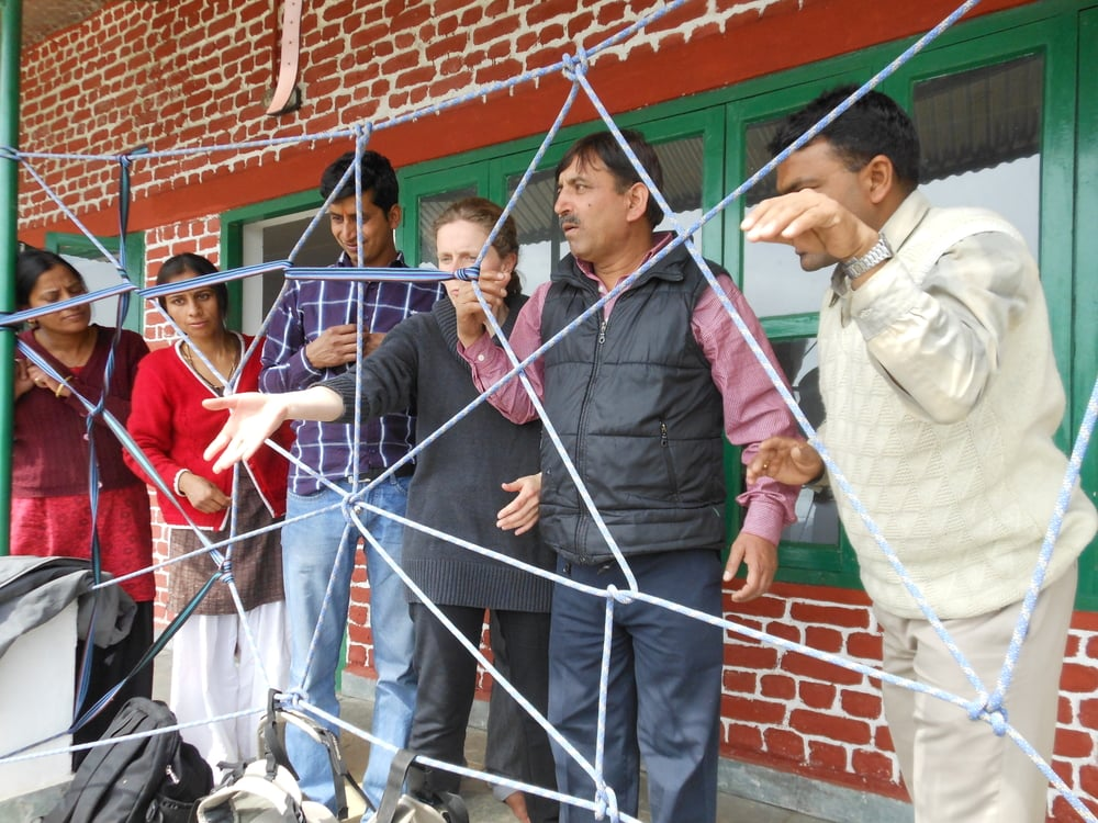 Nutting it out together: Problem solving at a team building workshop Uttarakhand India.