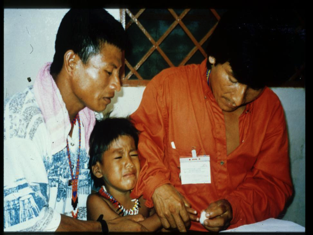 An indigenous boy (unhappily) gives our health workers a drop of his blood for a practice smear.
