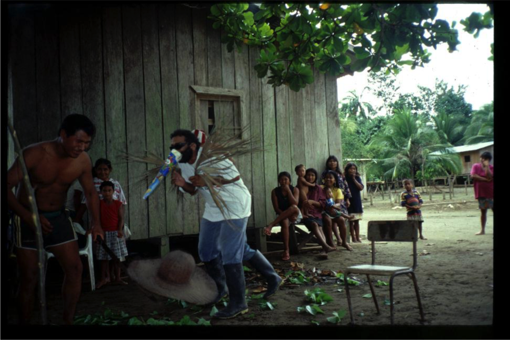 Community extension: With palm frond wings I role play a mosquito in an Embera village