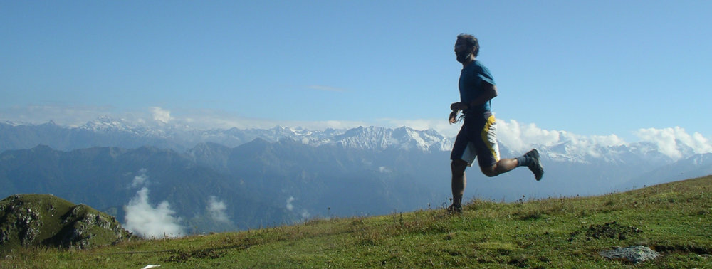 A training run. Clear air, blue skies and snow capped Himalayas smiling on... but its a patchy landscape.