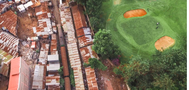 Between golf balls bursting from bunkers onto velvety greens and survival under rusty iron with freight trains barreling through is a social fence, historically constructed, invisible... impenetrable.