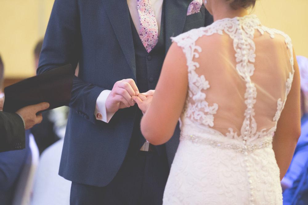 Newry Wedding Photographer | Armagh Wedding Photographer | Groom Placing Wedding Ring On Bride