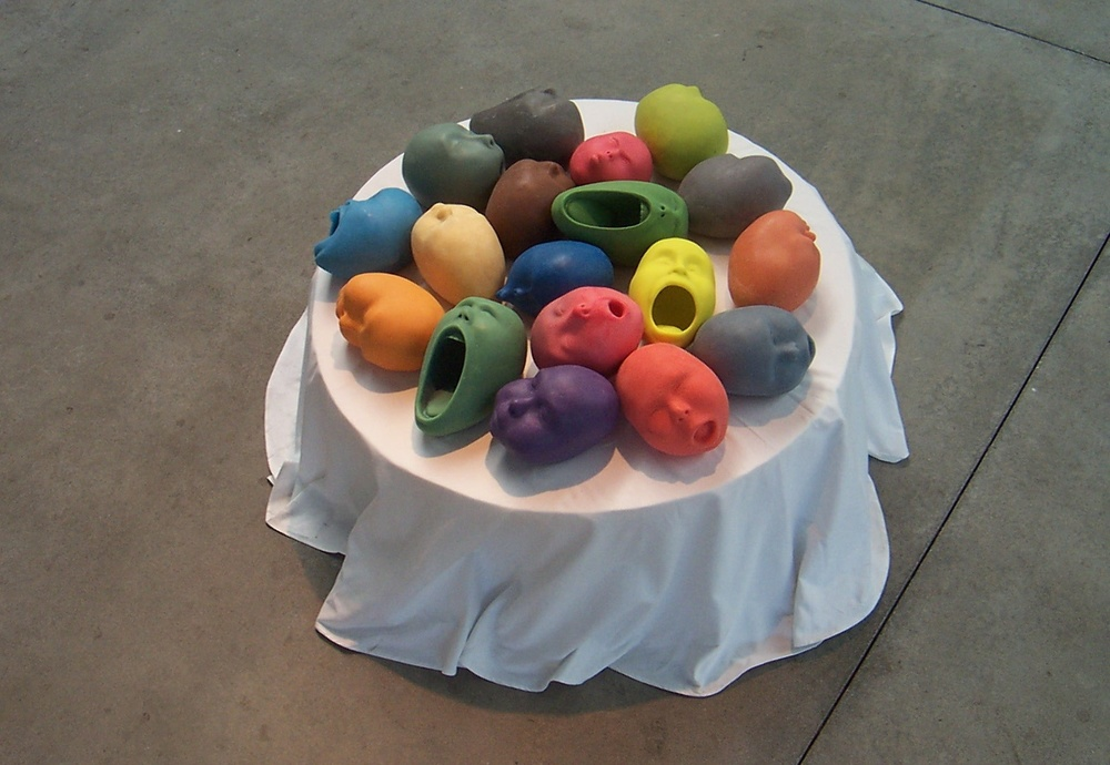 Hot heads (wax screamers & sleepers),  2008: wax, plaster, pigment, 9 x 36 x 36 inches