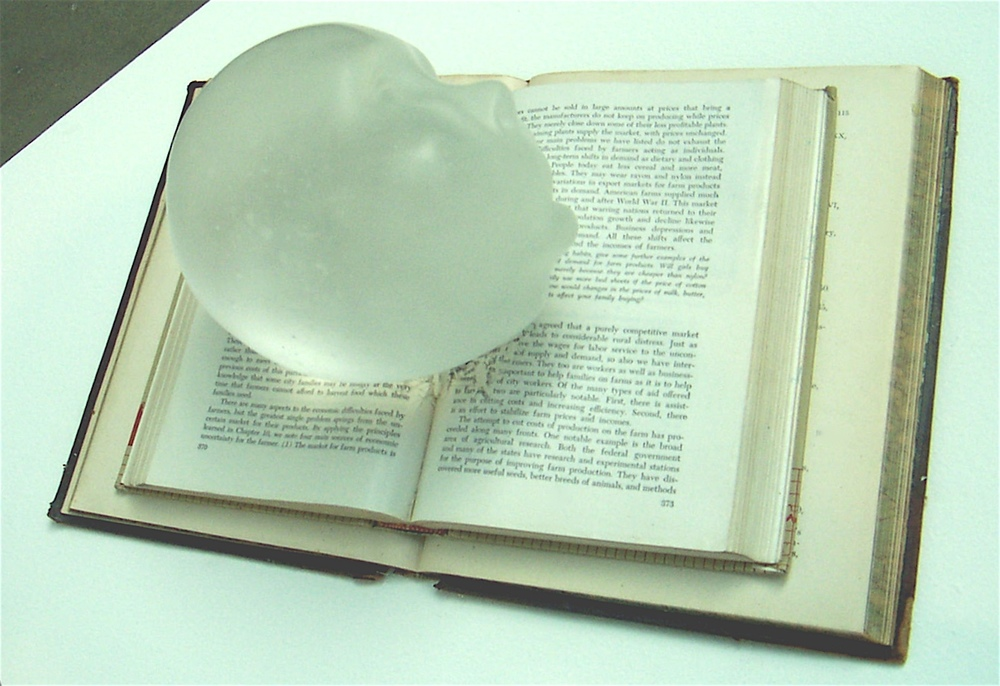 The age of reason (glass sleeper),  2008: lead crystal, books, 12 x 10 x 12 inches