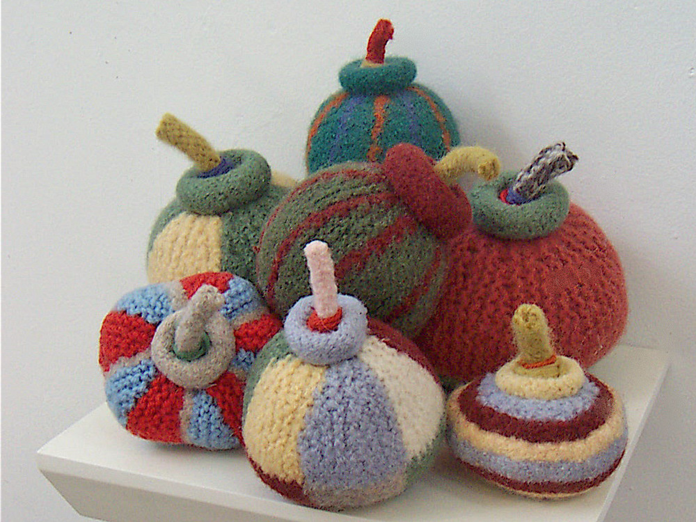 Study for Bomboozle , 2003: felted wool, polyester batting, dimensions variable (bombs 2 1/2-6 inches in diameter)