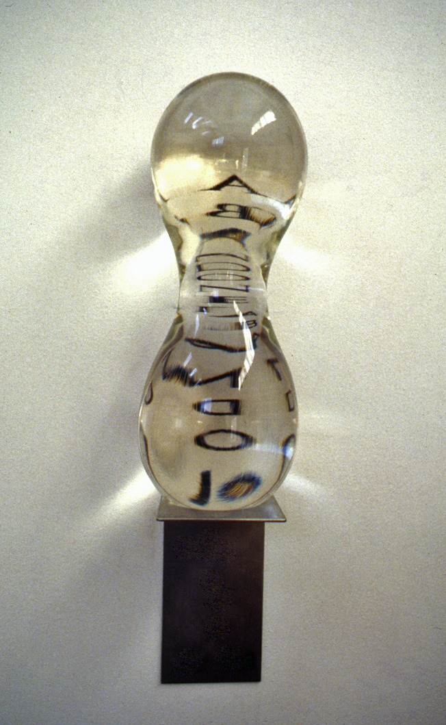 Squeezed,  1994: glass, text (on wall), steel