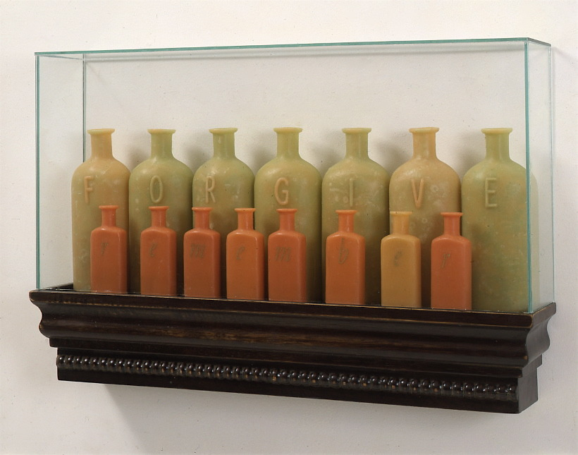 The virtues and vices of history,  1998: wax, wood, , metal leaf, glass; 13 x 24 x 4 inches. Back row: forgive. Front row: remember.