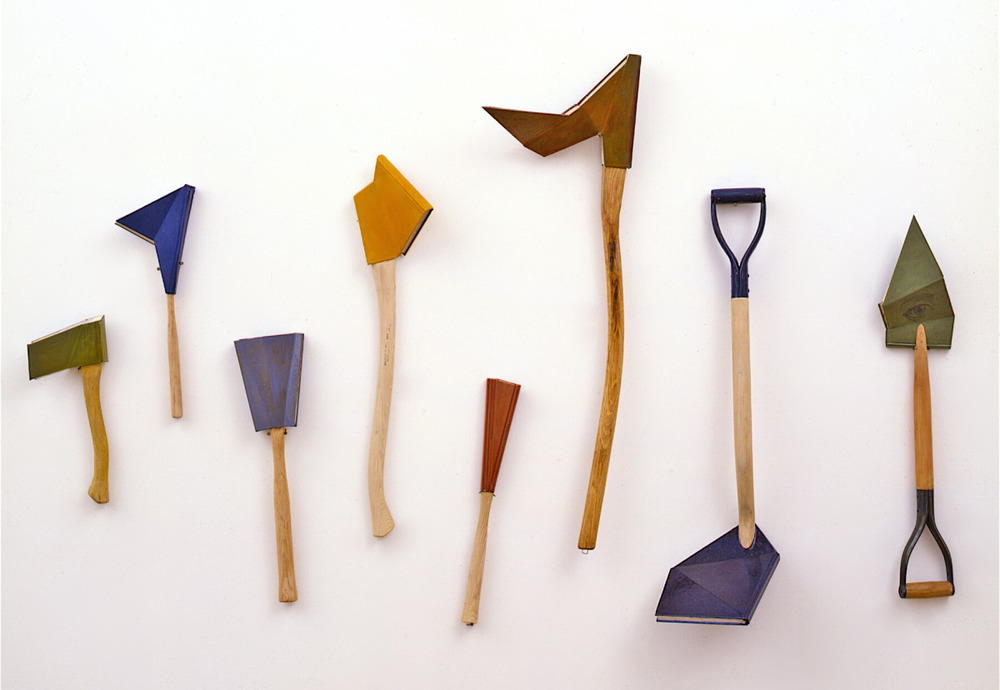 Implements of knowledge,  1992: wooden tool handles, books, oil paint; dimensions variable (the largest one is about five feet long).
