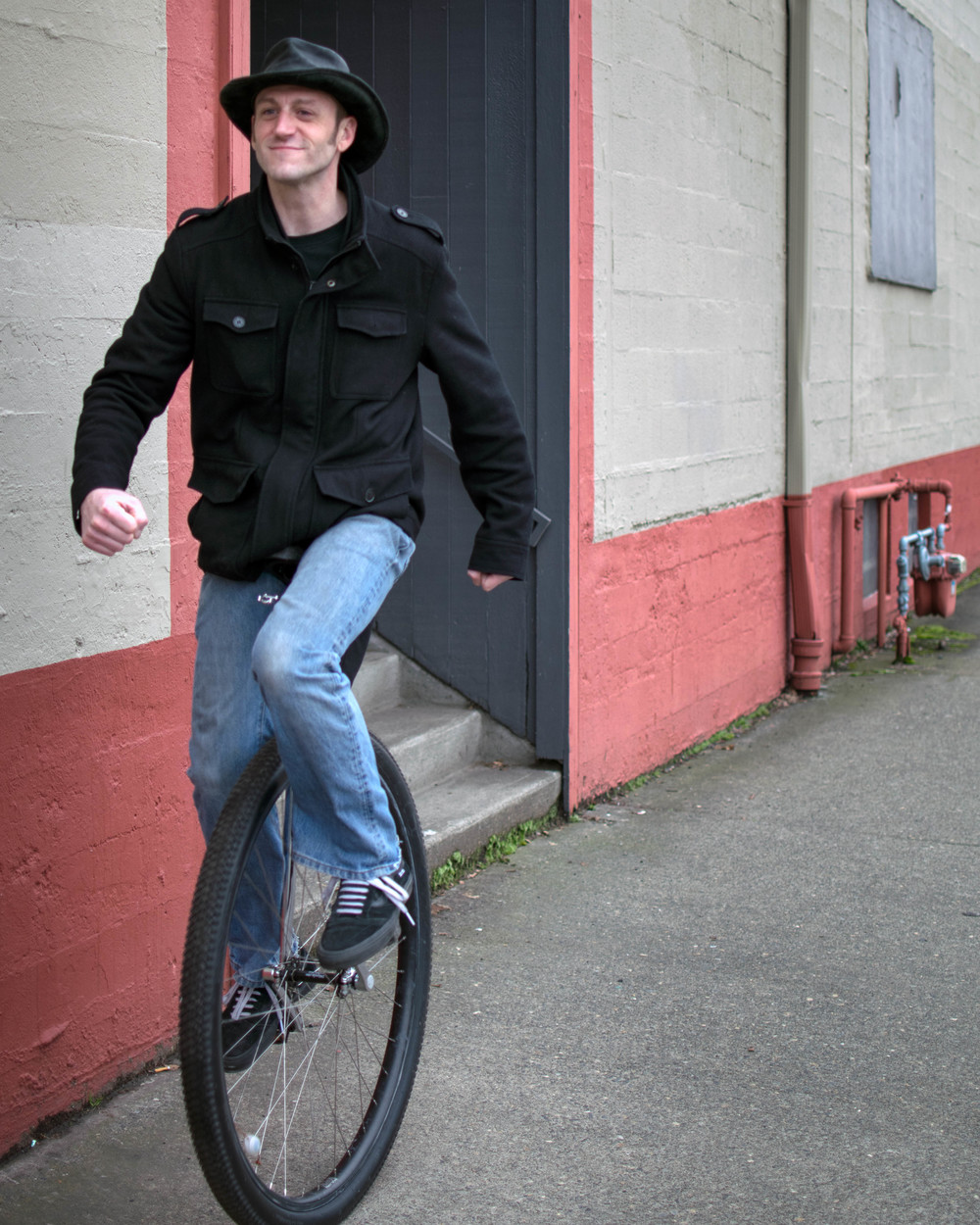 Unicyclist riding around town | Porland, OR