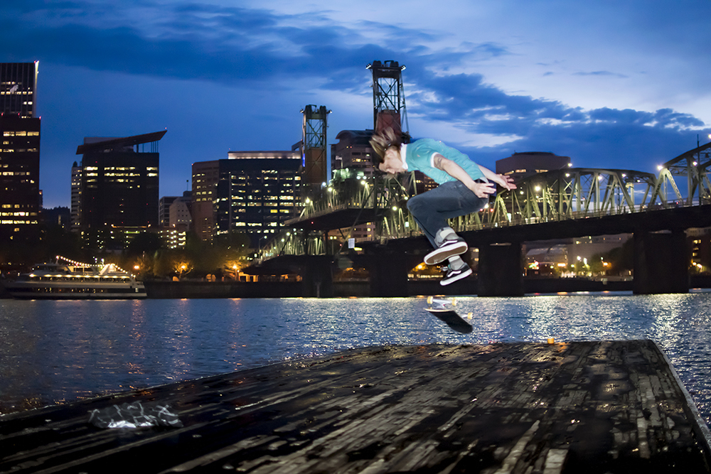 Kickflip on the docks by Hawthorne Bridge | Portland, OR