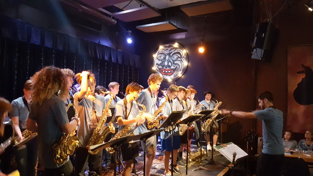 Dr. Evan Smith leads one of our student groups during a final performance at Seattle's storied Royal Room jazz club.