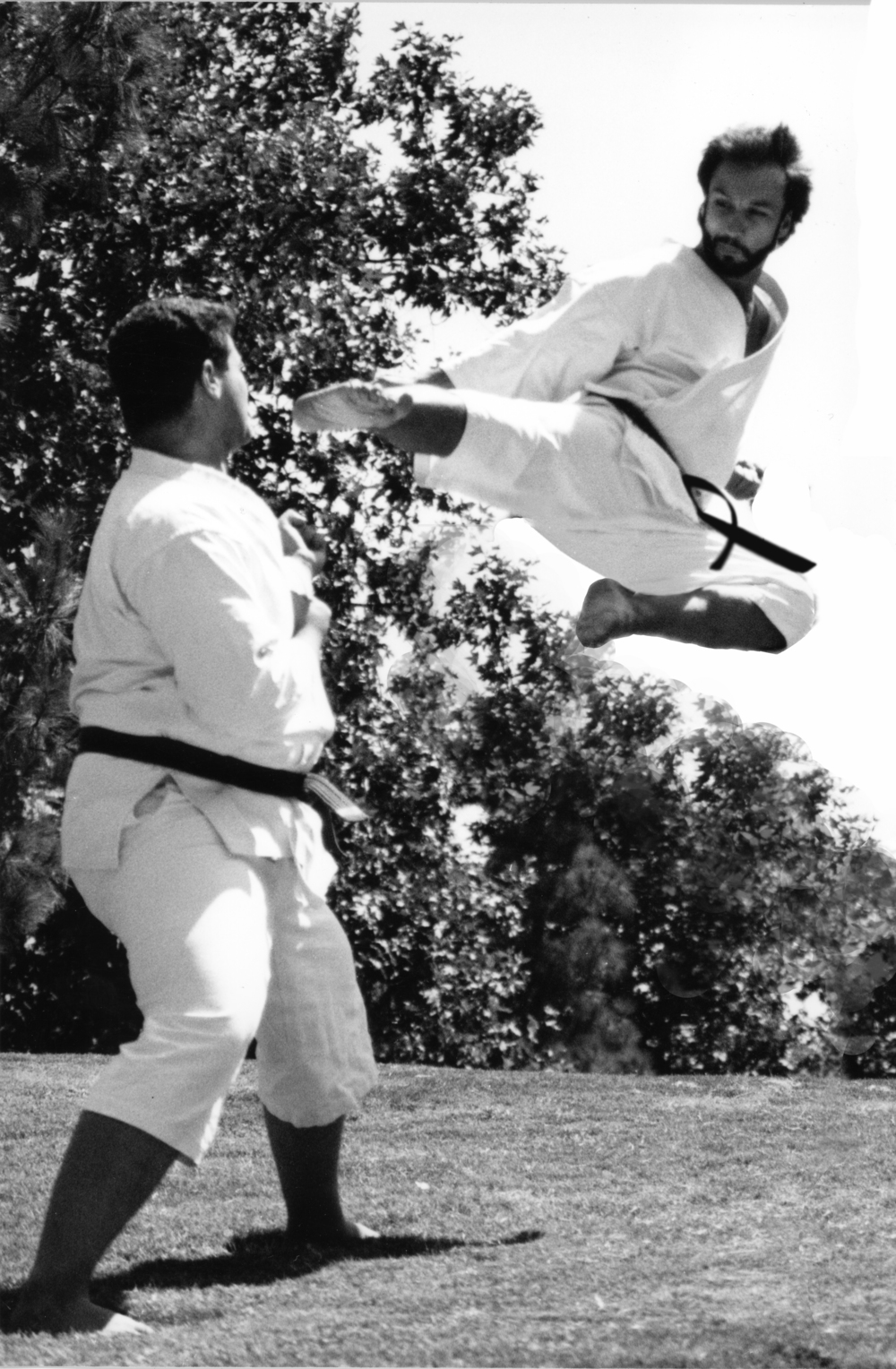 Ty Flying Side kick for Rec. dep PR photo with Mike Touma  assisting 1988.jpg