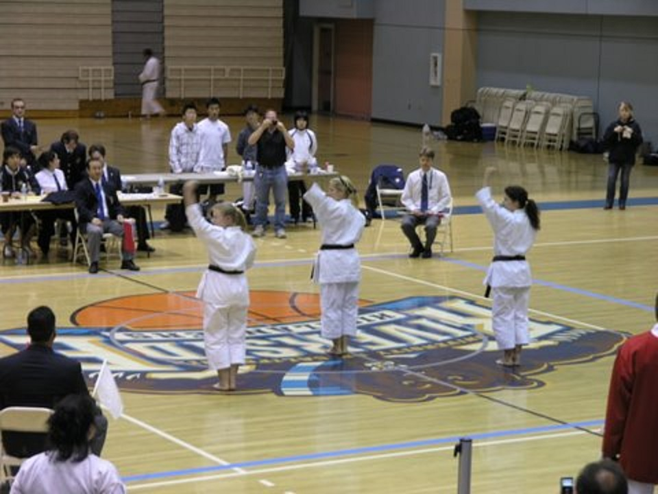 Lynn, Tatyana, and Carol competing at national karate tournament with coach (Sensei) P. Ringwood standing far right.jpg