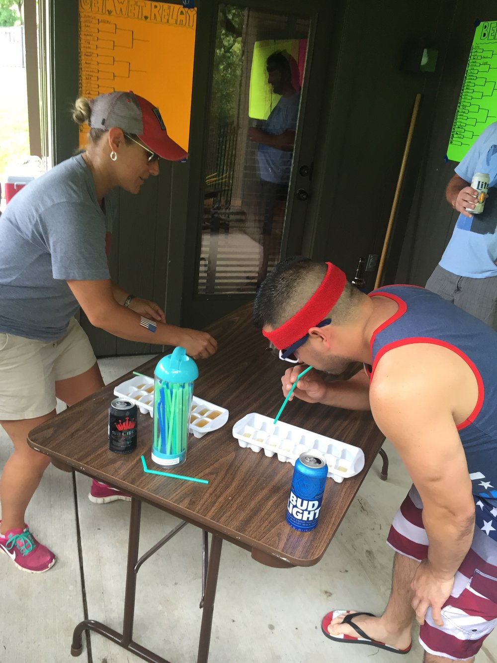 Dry Tri- includes chug and flip one cup, bounce a quarter into a glass, drink beer out of an ice cube tray with a straw…it is by far the hardest…drinking out of a straw is not good!