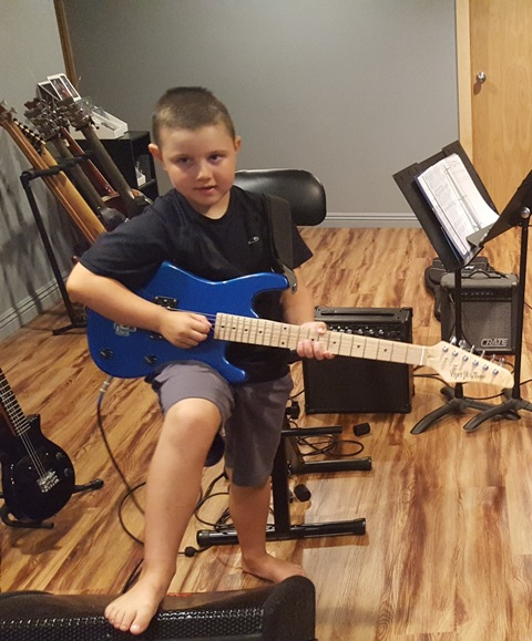 7 Year Old Vernon Hills Student Caden jamming out on the guitar during his guitar lesson.