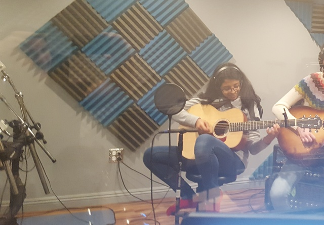Stevenson Freshman Suki Mohan recording during her guitar lesson with Mike Walsh.