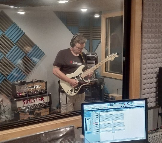 Guitar Student James Murphy of Greyslake IL soloing away during his guitar lesson.