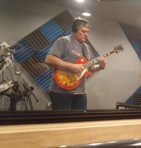 Guitar student Steve Delorge of Buffalo Grove recording like the king in his guitar lesson.