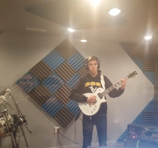Stevenson High School student Zach Melcher records another song like a pro in his guitar lesson.