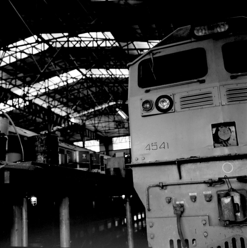 chromacomaphoto bangkok thailand film photography rolleiflex 3 5e xenotar delta 400 train shed depot service b and w (11).JPG