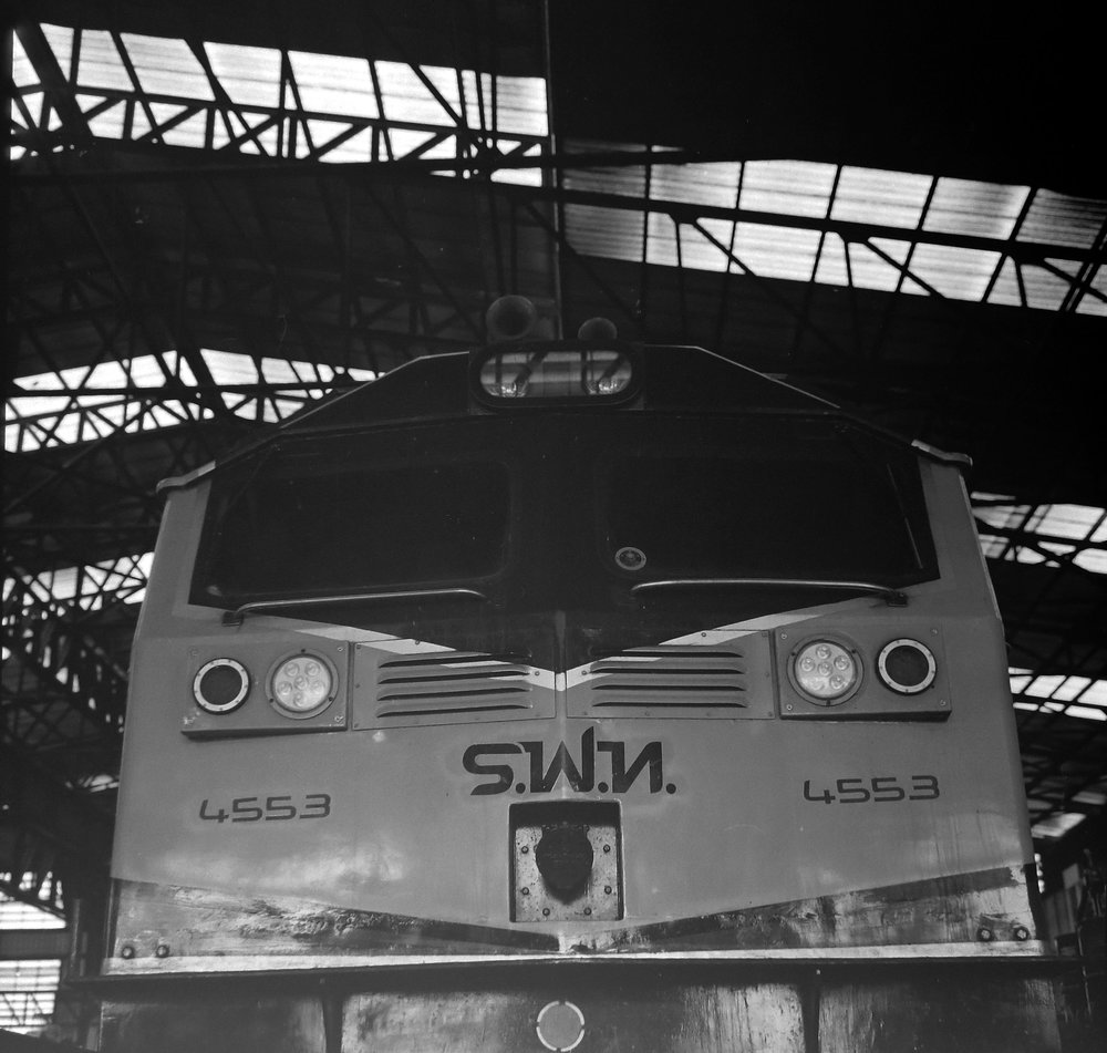 chromacomaphoto bangkok thailand film photography rolleiflex 3 5e xenotar delta 400 train shed depot service b and w (12).JPG