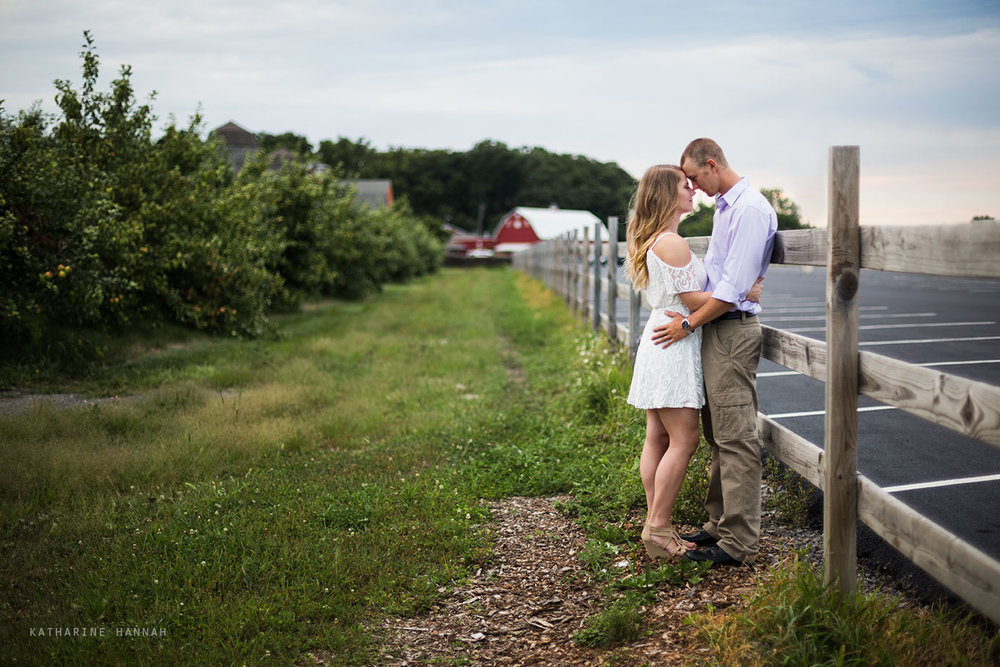 Couple at engagement photo session at County Line Orchard