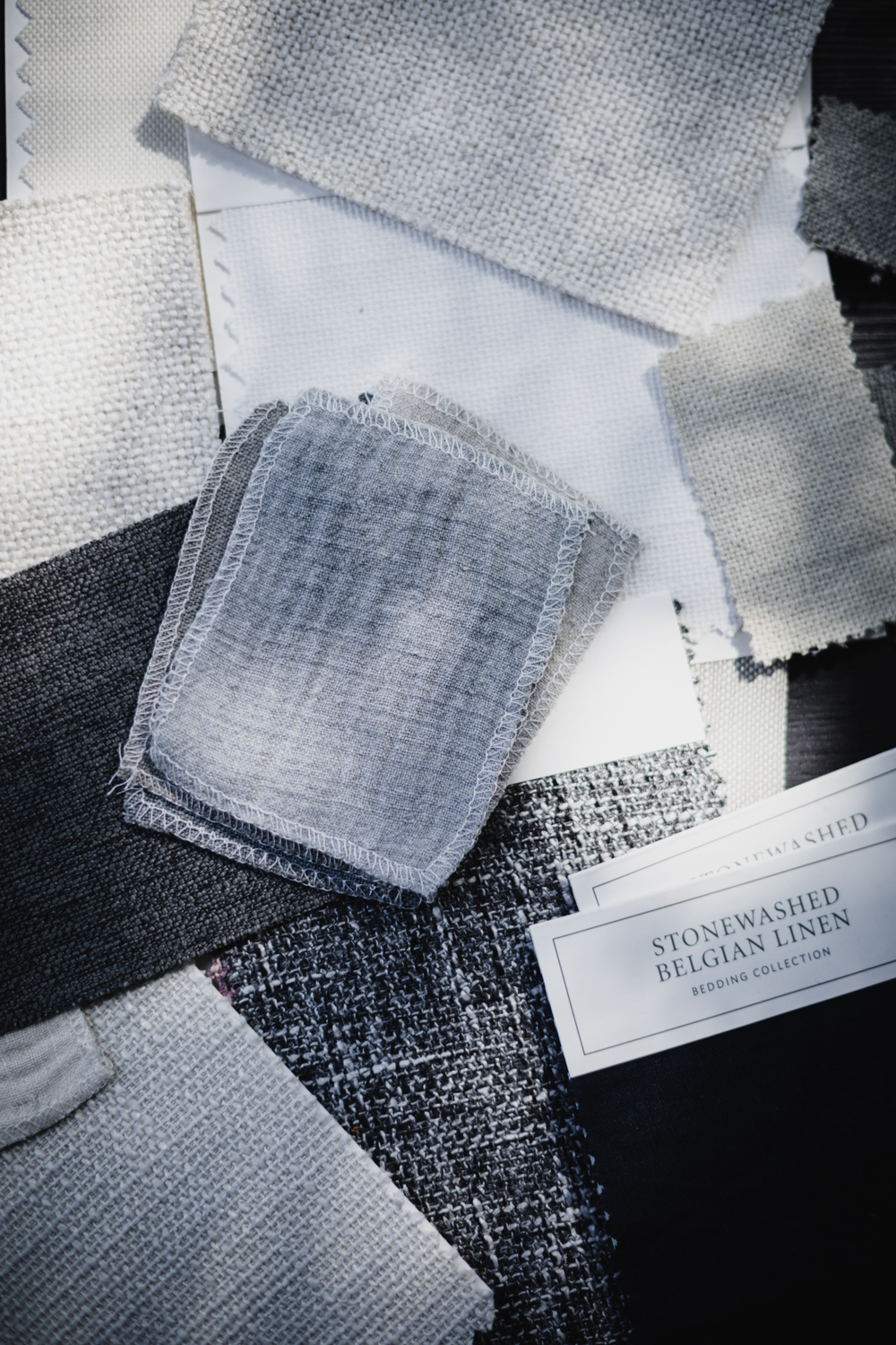Texture samples on the desk of interior designer Kira David Design for Inspired Chicago feature