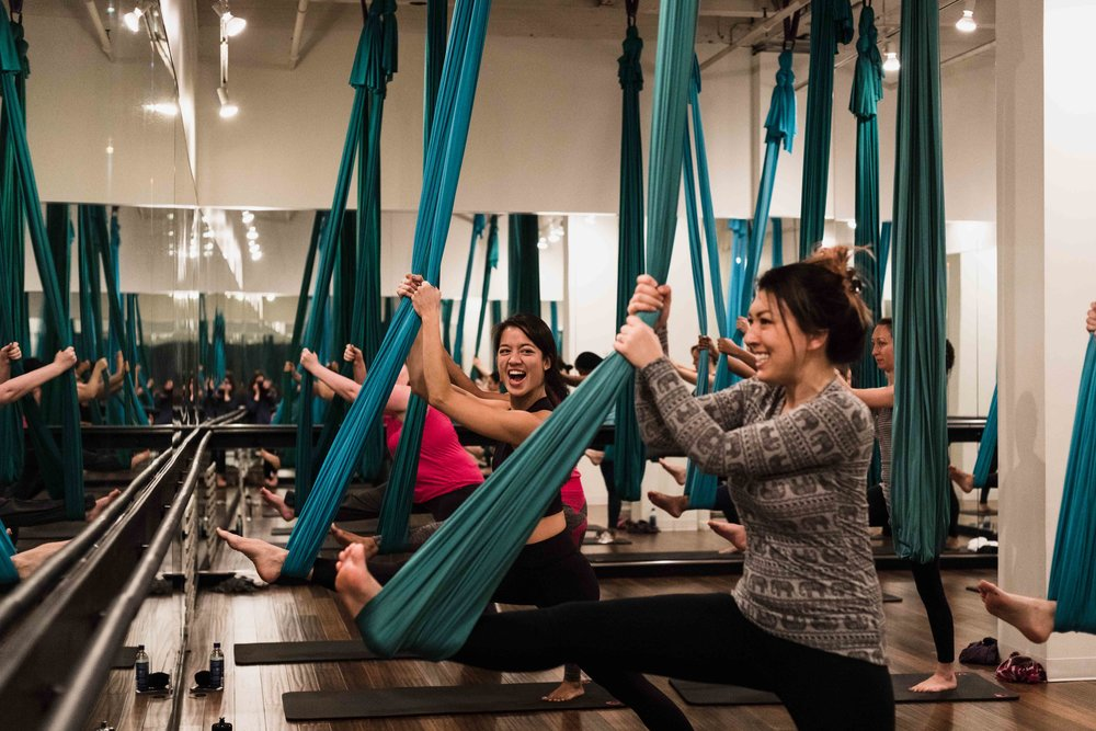 Aerial yoga led by Eat Stretch Nap in River North Chicago for Creative Women's Co.