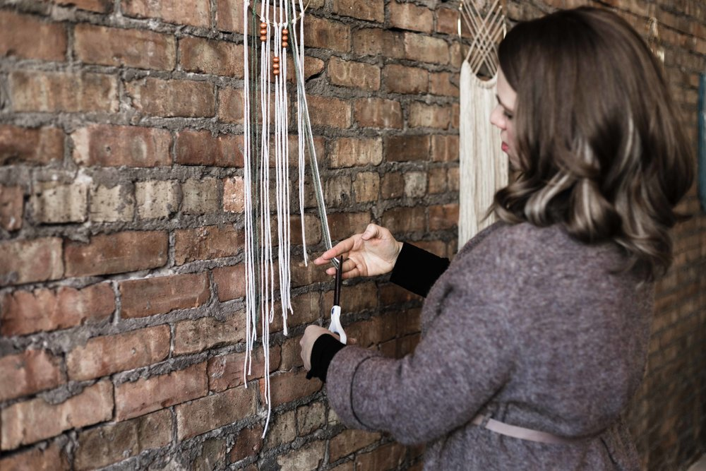 Leigh Hardy putting finishing touches on her dreamcatcher for The Glossary crafting event on Chicago's north side