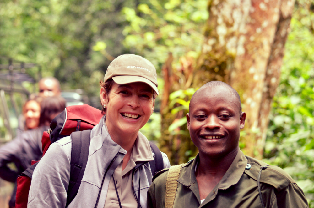 Our local park guide and a guest after tracking the mountain gorillas of Nshongi group.