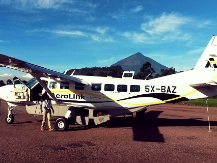 It is time to leave after an extraordinary journey with the mountain gorillas in Bwindi - Mt. Muhavura in the background.