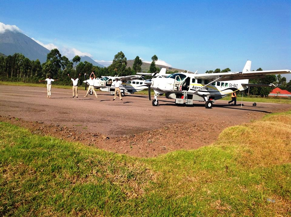 Staff having ablissful moment at Kisoro airstrip.jpg