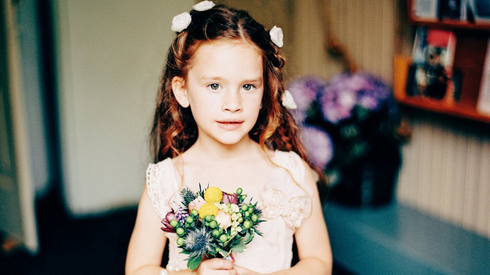 The Flower Girl holding her bouquet.