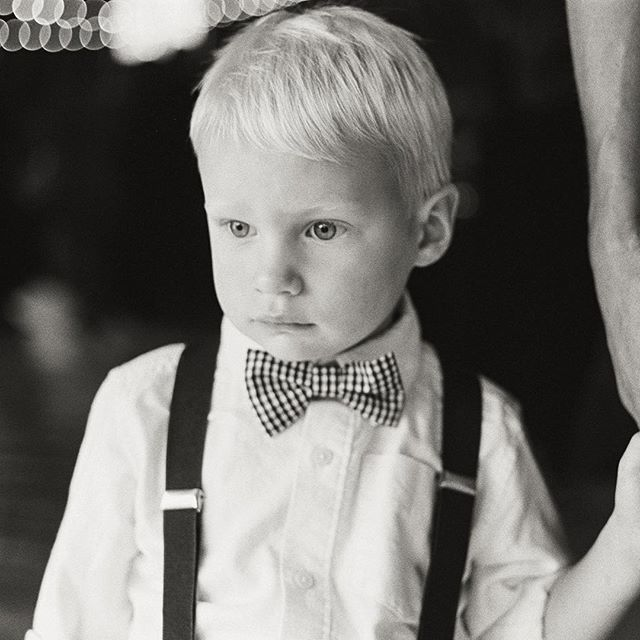 Portrait of the ring bearer ✌️️ . . #contaxg2 #minnesotawedding #weddingphotographer #minnesota #weddingphotography #bwphotography #bw #blackandwhite #filmisnotdead #analoguevibes #analogphotography #35mmfilm #35mm #photovision #ringbearer #kids #weddings