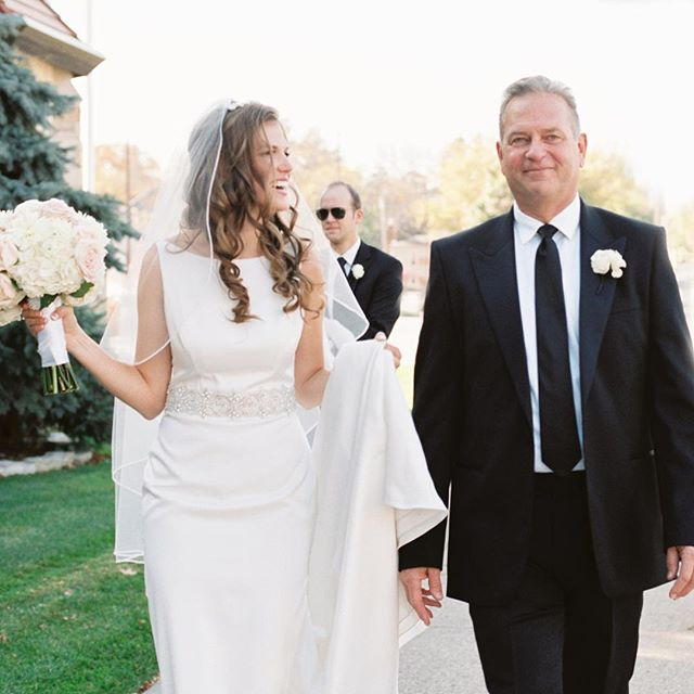 One highlight of many brides wedding day is that dirt look with her father.  This is a few moments after that, but you can see Brittany's exuberance just the same. . . . #analoguevibes #bridalstyle #firstlook #weddingday #weddingphotography #weddingphotographer #minneapolisphotographer #mnweddingphotographer #minnesotawedding #minnesotaphotographer #mnweddings #bride #brides #filmisnotdead #pentax645 #marcandreo #fuji400h #wedingphotographer