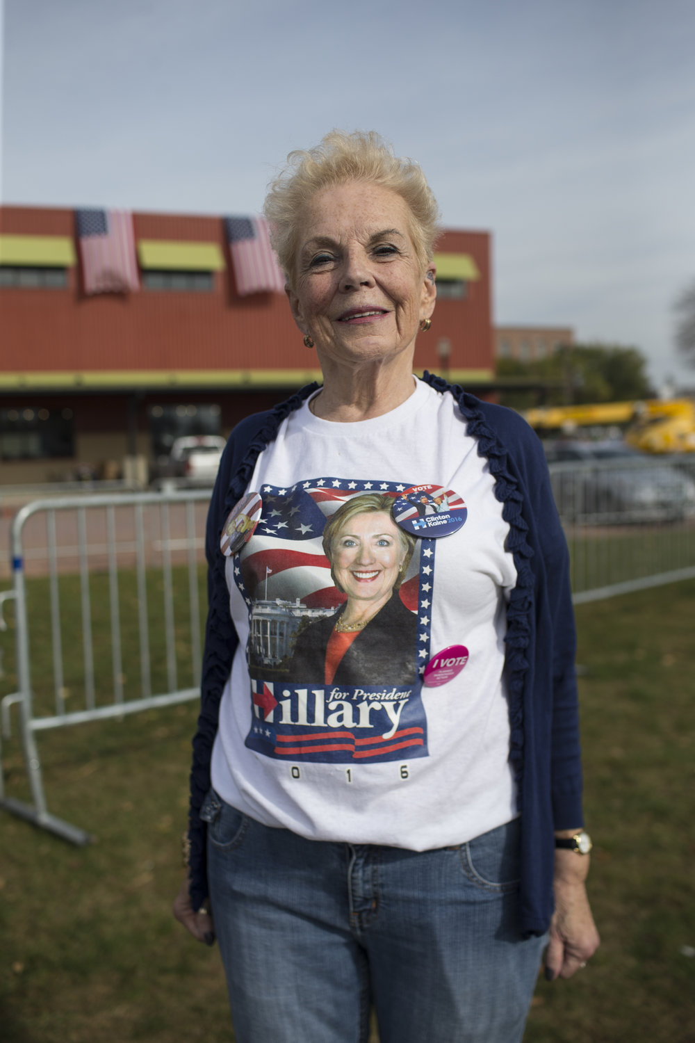 A woman poses for a photo following a Hillary Clinton Rally in Cedar Rapids, Iowa on Oct. 28, 2016. The rally was hosted in front of the NewBo City Market.