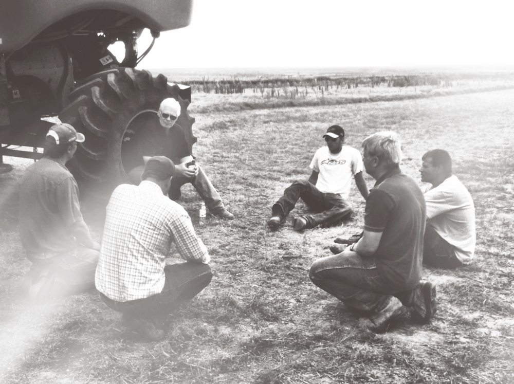One of my favorite pictures - my dad is the one sitting in the harvester tire.