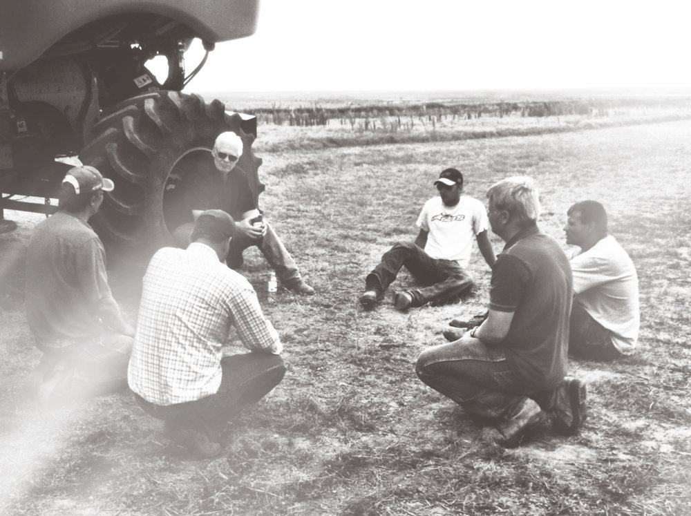 One of my favorite farm photos - my dad is the one sitting in the combine tire and my brother is in the white T-shirt.