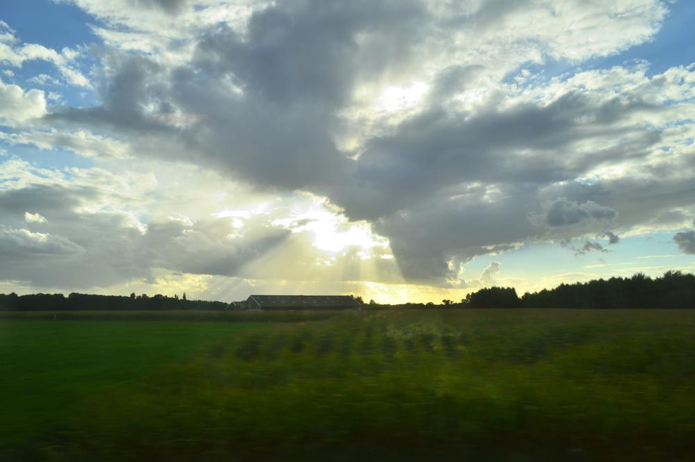 While on a train through Holland near Rotterdam, I saw the sun shining down on a farm  Nikon D3200 | 18mm | f/10 | 1/100s | ISO-100
