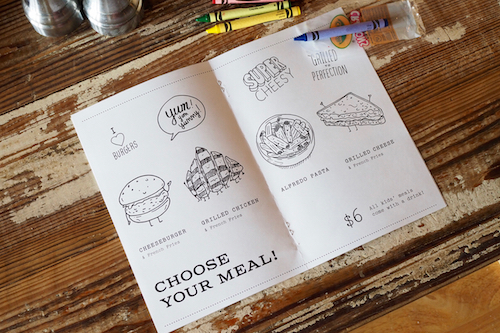 An approachable children's menu for kids to doodle while choosing their meal at South Main Kitchen, located in Alpharetta, GA.