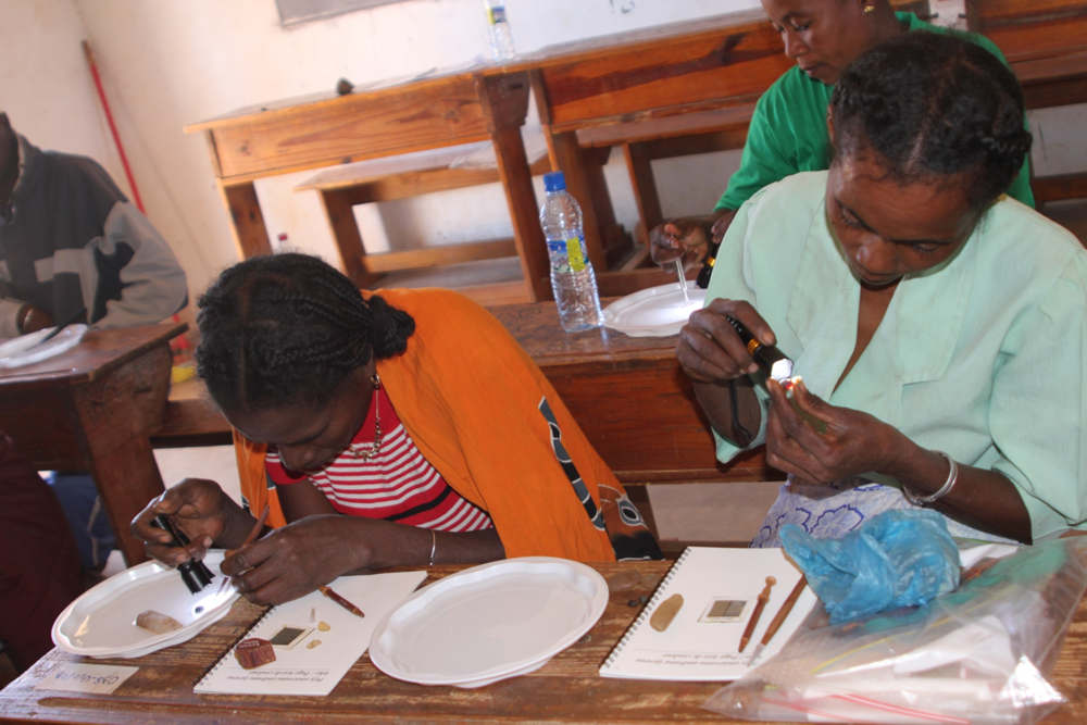 Women in Madagascar learning how to use basic gemmology equipment to identify their stones (Photo taken by Lynda Lawson)